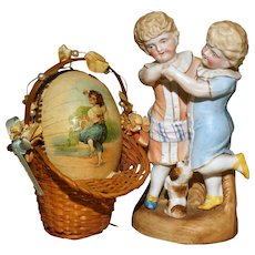 An Unusual CONTINENTAL EASTER EGG  Candy Container - Featuring European DANCING CHILDREN in National Dress.
