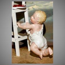 A MATRIX SUMMER SOUVENIR.!  Small Heubach Crawling Piano Baby with Oily Sheen Bisque.!