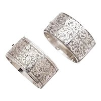 A Pair of Wide Victorian Floral Silver Cuffs