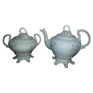 An Early Victorian English Teapot and Cover and a Sugar Pot and Cover