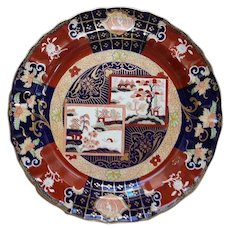 An Ashworth's Ironstone China Charger Double Landscape Pattern