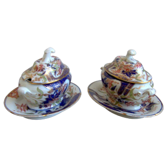 A Pair of Early Coalport Sauce Tureens and Stands in the Finger and Thumb Pattern