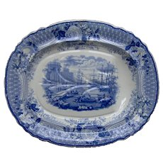 "A 19th Century Blue and White Transfer Printed Ironstone Platter ""Antique Subjects"""