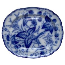 A Large Flow Blue Staffordshire Berry Pattern Platter
