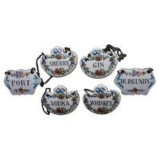 Six  Staffordshire Porcelain Wine Labels