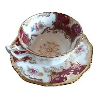 A Red Coalport Batwing  Cup and Saucer