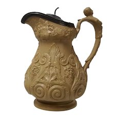 A Drabware Bacchus & Pan Relief Molded Pewter Lidded Pitcher
