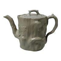 A Drabware Relief Molded Stoneware Teapot