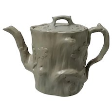 A Drabware Relief Molded Stoneware Teapot