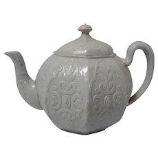 A Relief Molded White Stoneware Teapot
