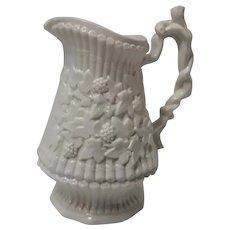 A White Glaze Relief Molded Stoneware Jug