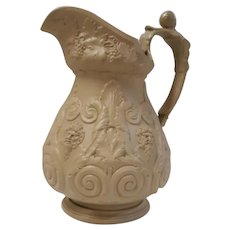 A Large Drabware Bacchus & Pan Relief Molded Pitcher