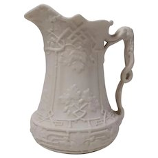 A Parian Relief Molded Dry Bodied Jug Trellis pattern