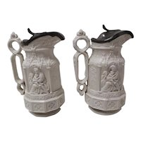 A Pair of York Minster Relief Molded Jugs with Metal Lids
