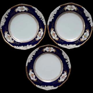 A Set of Three Coalport Dinner Plates