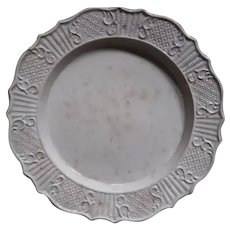 An Eighteenth Century Staffordshire Salt Glazed Plate