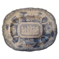 """A Blue and White Transfer Printed Platter in the """"Antiques"""" Pattern."""