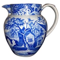 A Staffordshire Blue and White Transfer Printed Jug
