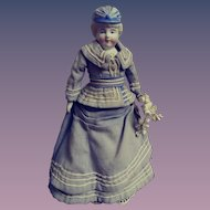 "Unmarked Bisque Bonnet Doll - 9"" Tall"