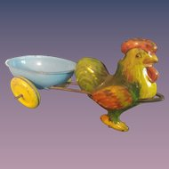 "Tin Rooster and Egg Cart - 9"" Long"