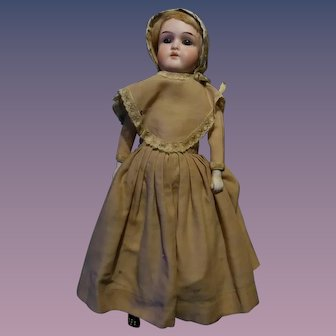 German Doll Dressed In Traditional Shaker Ensemble.