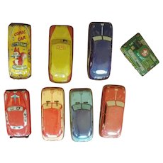 Seven Vintage Tin Cars and One Tank - 1950s to 1960s