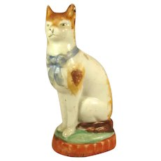Staffordshire Early Miniature Cat on a Cushion, C.1840.