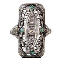 Circa 1910 18k White Gold Edwardian Filigree Ring with Diamonds and Emeralds