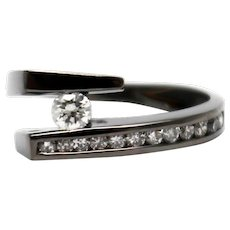 Amazing Natural Diamond Tension Set Solitaire  Ring in 14KT Gold with Black Rhodium