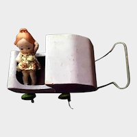 Lavender Painted Hand Carved Wood Mini Buggy with Apple Green Wood Wheels and Metal Push Handle and Bisque Ribbon Holed Hair