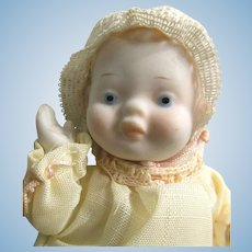 """SHACKMAN Baby with Original Sticker: 5 Joint Bisque 5.5"""" Doll Turned Head, Pale Yellow Synthetic Dress with Pink Cord Trim"""