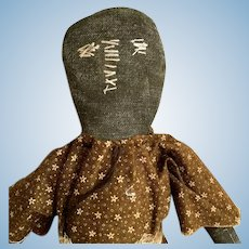 Child's Black PLAY DOLL Carolina's 1930-1940; Cloth Hard Stuffed Body with Brown Calico Dress and Sackcloth Apron. Hand Embroidered Face and Under Garment