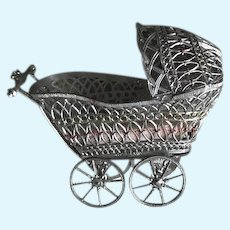 Silver Filigreed Pink Accented Small Baby Buggy with Movable Wheels and Bisque Baby