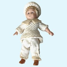 Mini Celluloid Infant With Wig and Knit Clothing