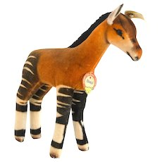 "STEIFF OKAPI 6414,0; 7"" tall, 6"" long, 1958; Soft Brown Velvet, Felt Ears, Braided Tail; Dark Brown Glass Eyes, Hand Stitched Mouth"