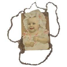 Late 19th C. Infant Girl Scrap Tinsel Christmas Ornament