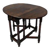 18th c. English Carved Oak Drop leaf Table on Sausage Turned Legs