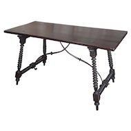 Spanish Revival walnut Table with Iron stretcher bars