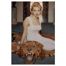 Slim Aarons -Beautiful Lady Daphne Cameron on a Tiger Skin Rug - 1959 Photograph