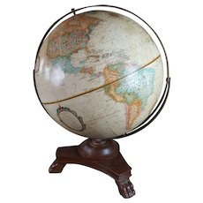 Vintage Globe with carved wooden Claw feet stand