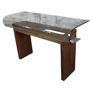 Modern walnut console table with curved glass top