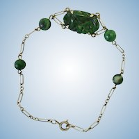 Art Deco silver carved floral deep green jade bracelet