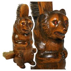 "Antique Victorian Era Black Forest Carved 11"" Seated Bear, a Clothes Brush Caddy"