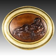 """Antique Hand Carved Plaque in French Frame, Infant or Cupid at Rest, 18.5"""" x 15.5"""" Oval"""