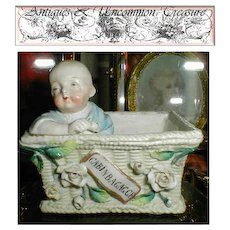 Conte & Boehm Cold Paste Porcelain Match Holder/Striker with Baby in Basket