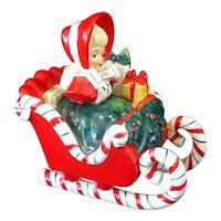 Lefton Christmas Shopper Girl in Candy Cane Sleigh