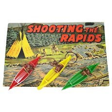 Shooting The Rapids Indians in Canoes 1940s Dimestore Toy