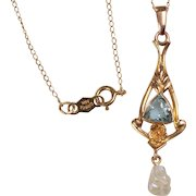 "Vintage 14kt Lavaliere with 18"" Chain: set with a triangular, faceted blue topaz, and a Freshwater Pearl"
