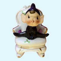 Mid-Century Ceramic Pixie Elf in a Chair Made in Japan Figurine