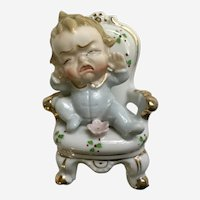 Cry Baby Sitting in Chair Porcelain Figurine